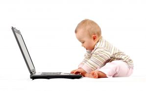 Funny baby with Laptop